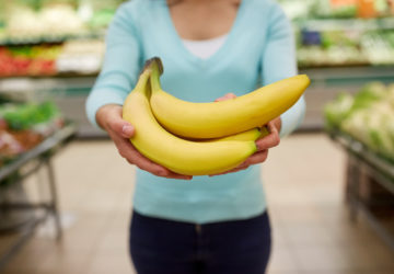 woman with bananas at grocery store