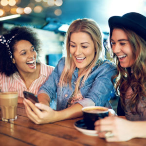Women with with smartphone laughing